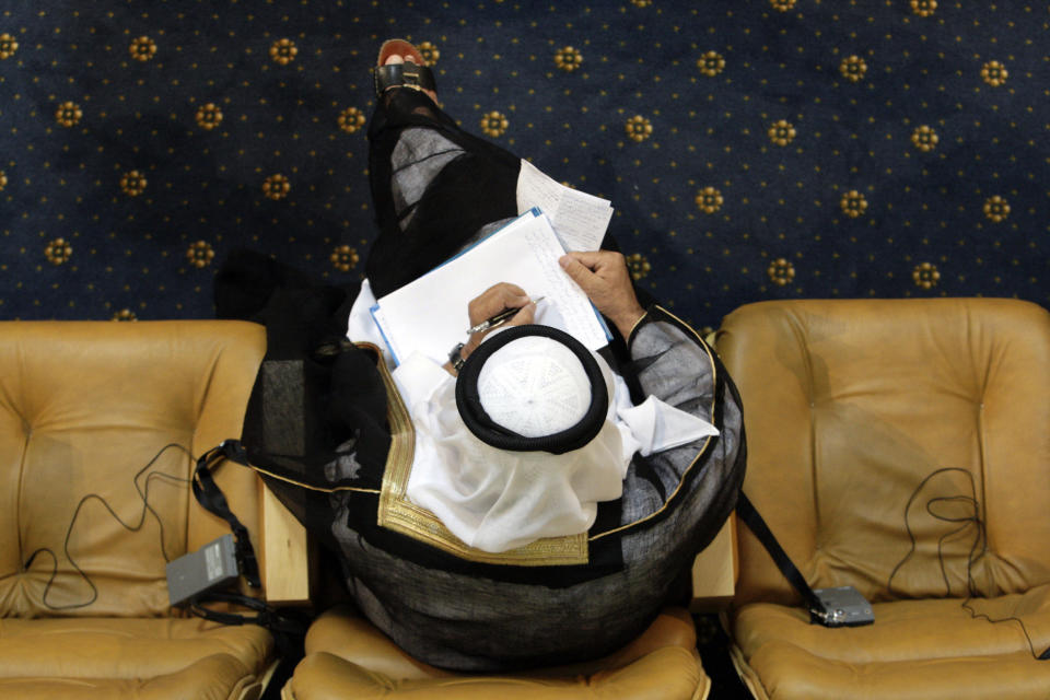 An Arab delegate takes notes at the Nonaligned Movement summit in Tehran, Iran, Friday, Aug. 31, 2012. (AP Photo/Vahid Salemi)
