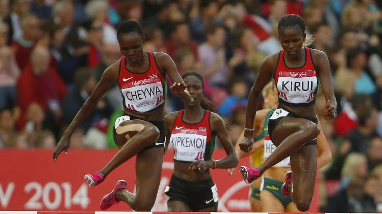 Kirui of Kenya clears the final hurdle ahead of her compatriot Cheywa to win the women's 3000 metres steeplechase finaat the 2014 Commonwealth Games in Glasgow