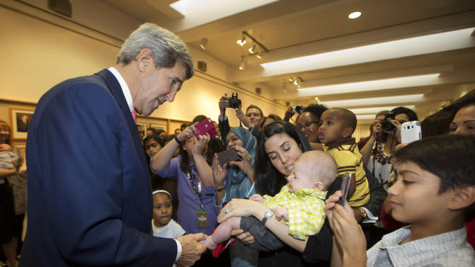 "U.S. Secretary of State John Kerry greets the children of U.S. Embassy employees during a visit to the facility in Riyadh Monday, Nov. 4, 2013. Seeking to bridge multiple policy rifts with Saudi Arabia, Kerry is praising the kingdom's role as ""the senior player"" in Middle East security. He says cementing the U.S.-Saudi partnership on issues like Syria, Egypt and Iran are critical to regional stability. Speaking to employees at the U.S. Embassy in Riyadh on Monday, Kerry said that Saudi Arabia had assumed the Arab leadership mantle from Egypt, which is embroiled in political uncertainty. (AP Photo/Jason Reed, Pool)"