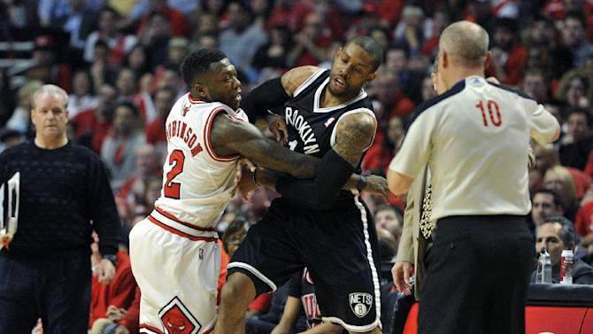 Chicago Bulls' Nate Robinson (2) and the Brooklyn Nets' C.J. Watson get into a scuffle during the first half in Game 4 of their first-round NBA basketball playoff series Saturday, April 27, 2013, in Chicago. (AP Photo/Jim Prisching)