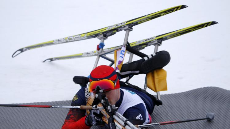 Russia's Goncharov shoots during the men's 15 km biathlon sitting at the 2014 Sochi Paralympic Winter Games in Rosa Khutor