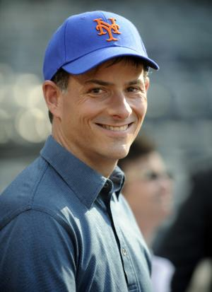 FILE - A Monday May 30, 2011 photo from files showing David Einhorn watching batting practice before the baseball game against the Pittsburgh Pirates at Citi Field in New York. Britain's Financial Services Authority says it has fined hedge fund mogul David Einhorn and his U.S.-based Greenlight Capital Inc. 7.2 million pounds ($11.2 million) for insider trading. The UK watchdog said in a statement Wednesday, Jan. 25, 2012, that Einhorn was tipped off to the fact that leading British pub operator Punch Taverns PLC was about to begin raising money before he sold millions of the company's shares on June 9, 2009. (AP Photo/Bill Kostroun, File)