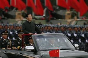 File photo shows Chinese President Hu Jintao at a military…
