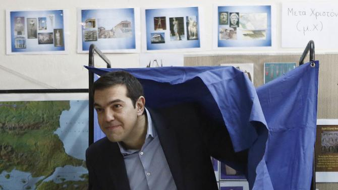 Opposition leader and head of radical leftist Syriza party Tsipras leaves the voting booth at a polling station in Athens