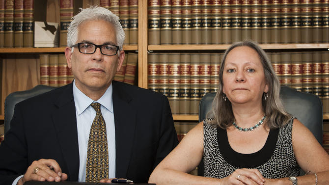 "In this July 1, 2011, photo, Sandra Rawline, 52, right, poses with her lawyer Robert ""Bigs"" Dowdy at the Law Offices of Tom F. Coleman in Galveston, Texas. Rawline has filed an age discrimination and retaliation lawsuit against her former company, Capital Title of Texas, and alleges that she was told to wear younger outfits and dye her gray hair. (AP Photo/The Houston Chronicle, Patrick T. Fallon) MANDATORY CREDIT"