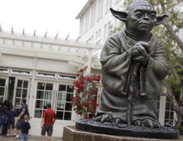 FILE - This Aug. 2, 2011 file photo shows a life-sized replica of Yoda, George Lucas&#39; master of the Force, at Lucasfilm Ltd. production studios in San Francisco. The Northern California city of San Anselmo has approved a new downtown park to be built on land donated by Lucas that will feature statues of Indiana Jones and Yoda, two of his most popular characters. (AP Photo/Paul Sakuma, File)