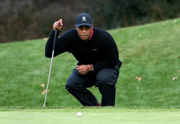Tiger Woods lines up a putt on the fifth hole during the second round of the Northwestern Mutual World Challenge at Sherwood Country Club on December 6, 2013 in Thousand Oaks, California