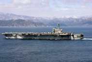 File photo of the aircraft carrier USS Ronald Reagan in the Pacific, off the coast of Japan. Australia has decided that while increased US access to its naval base HMAS Stirling was possible long-term, American aircraft carriers will not be based in Australia
