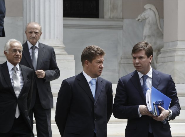 Gazprom Chief Executive Officer Miller leaves the office of Greece's Prime Minister Samaras after a meeting in Athens