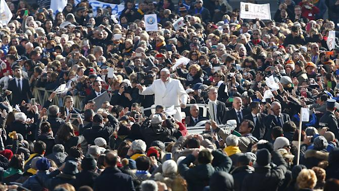 Pope Francis waves as he arrives to lead a special audience to celebrate a jubilee day for the mystic saint Padre Pio in Saint Peter's square at the Vatican