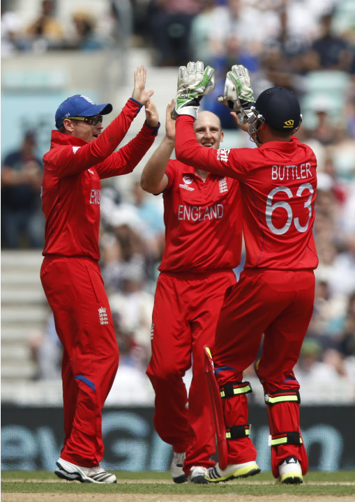 England's James Tredwell, center, celebrates his wicket of South Africa's Jean-Paul Duminy with teammates during their ICC Champions Trophy semifinal cricket match at the Oval cricket ground in London