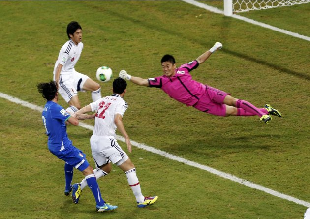 Japan's goalkeeper Eiji Kawashima dives to make a save during their Confederations Cup Group A soccer match against Italy at the Arena Pernambuco in Recife