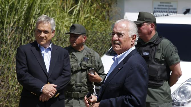 Former presidents from Chile's  Pinera  and Colombia's Pastrana are stop by national guards outside the military prison of Ramo Verde at the outskirts of Caracas