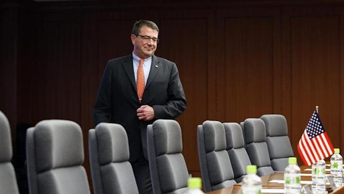 Ashton Carter walks towards his seat at the start of a meeting with Japanese Senior Vice Defence Minister Shu Watanabe (not pictured) in Tokyo July 20, 2012. REUTERS/Yuriko Nakao/Files