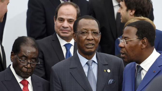 Zimbabwe's President Mugabe, Egyptian President Abdel Fattah el-Sisi, Chad's President Deby and Benin's President Thomas Yayi pose pose for a family photo during the opening day of the World Climate Change Conference 2015 (COP21) at Le Bourget, near Paris
