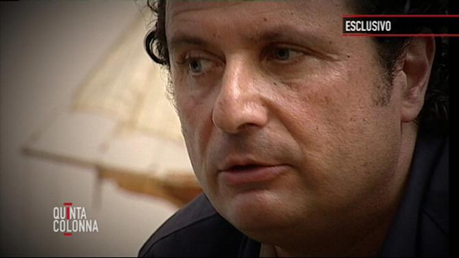 """In this frame grab taken from video and released by Italian media conglomerate Mediaset on Tuesday, July 10, 2012, Francesco Schettino, the captain of the Costa Concordia cruise ship which ran aground in January off the coast of Isola del Giglio, Italy, killing more than 30 people, is seen during an exclusive interview to the """"Quinta Colonna"""" programme that was broadcast, Tuesday, July 10, 2012 on Mediaset Channel 5. Schettino is accused of causing the ill-fated cruise liner to hit rocks off the coast of Tuscany's Isola del Giglio on January 13, 2012, killing 32 people when the ship capsized and sank with over 4,000 people on board. Schettino, who was released from house arrest on Thursday July 6, denies the charges against him that include manslaughter, causing a shipwreck and abandoning ship. (AP Photo/Mediaset, HOEP)"""