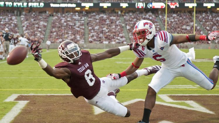 Texas A&M's Jeff Fuller (8) tries to reach a pass as SMU's Richard Crawford (6) defends during the first quarter of an NCAA college football game, Sunday, Sept. 4, 2011, in College Station, Texas. Crawford was flagged for interference on the play. (AP Photo/Dave Einsel)
