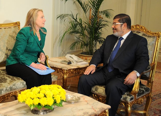 In this photo released by the Egyptian Presidency, U.S. Secretary of State Hillary Rodham Clinton, left, meets with Egyptian President Mohammed Morsi, right, in Cairo, Egypt, Wednesday, Nov. 21, 2012.