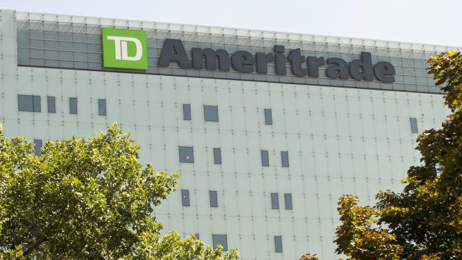 In this Monday, July 16, 2012, photo, TD Ameritrad's new corporate headquarters which is still under construction stands in Omaha, Neb.  Online brokerage TD Ameritrade's net income slipped 2 percent as trading slowed, but the company beat Wall Street expectations because expenses were down and investors entrusted the firm with more money. Ameritrade CEO Fred Tomczyk said Tuesday, July 17, 2012, that the company believes its strategy is helping it weather the challenging conditions. (AP Photo/Nati Harnik)
