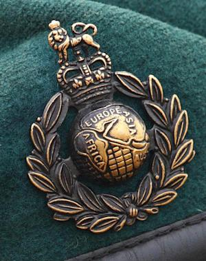 FILE - In this Jan. 21, 2010 file photo a Royal Marines Commando cap badge is seen. Five Royal Marines have been charged with murder over a death in Afghanistan last year, Britain's Ministry of Defense said Sunday Oct. 14, 2012. They are the first British troops to be charged with murder in the country since deployments began in 2001. (AP Photo/PA, Chris Ison, file) UNITED KINGDOM OUT  NO SALES  NO ARCHIVE