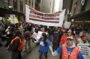 File photo of demonstrators marching during a Chicago Teachers Union protest in Chicago