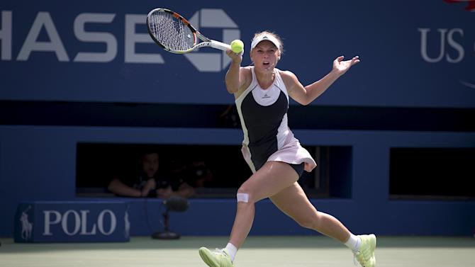 Caroline Wozniacki of Denmark returns the ball to Jamie Loeb of the U.S. during their match at the U.S. Open Championships tennis tournament in New York