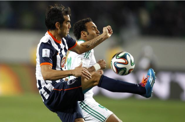 Issam Erraki of Morocco's Raja Casablanca fights for the ball with Cesar Delgado of Mexico's Monterrey during their FIFA Club World Cup soccer match in Agadir