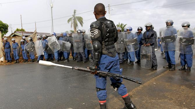 Riot policemen stand in a formation during street protests in Burundi's capital Bujumbura