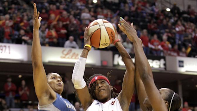 Indiana Fever guard Shavonte Zellous (1) shoots between Minnesota Lynx defenders  Maya Moore (23) and  Taj McWilliams-Franklin, right, in the first half of Game 3 of the WNBA basketball Finals, Friday, Oct. 19, 2012, in Indianapolis. (AP Photo/AJ Mast)