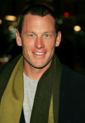 Champion cyclist Lance Armstrong smiles for the cameras at the 'We Are Marshall' premiere  -- Getty Images