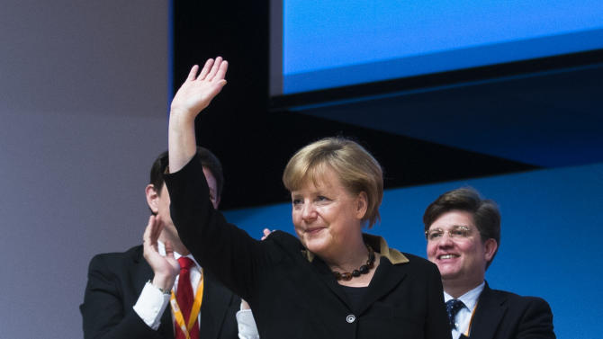 German Chancellor and chairwoman of the Christian Democratic Party, CDU, Angela Merkel waves to the delegates after her keynote speech at the Party's 2012 convention in Hannover, Tuesday, Dec. 4, 2012. The ruling CDU will elect a new board and reelect Angela Merkel as the party's chairwoman at the convention. (AP Photo/Markus Schreiber)