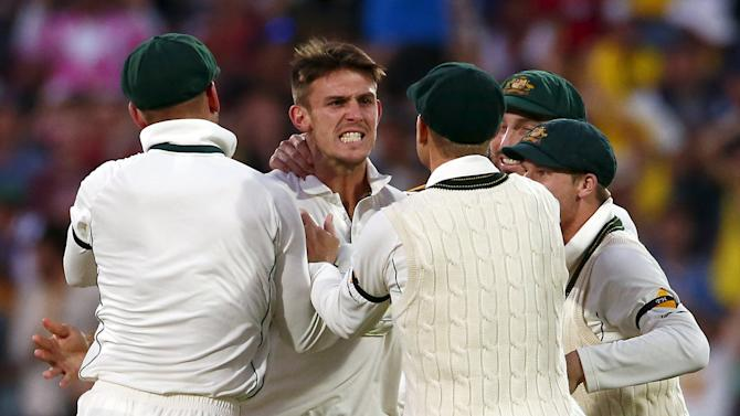 Australia's Mitchell Marsh celebrates with team mates after he dismissed New Zealand's Kane Williamson for nine runs during the second day of the third cricket test match at the Adelaide Oval, in South Australia