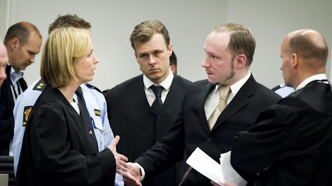 Accused Norwegian Anders Behring Breivik, second right, talks to public prosecutor Inga Bejer Engh at the courtroom, in Oslo, Norway, Tuesday April 17, 2012. The anti-Muslim fanatic who admitted to killing 77 people in a bomb-and-shooting massacre is set to take the stand in his terror trial. Anders Behring Breivik will have five days to explain why he set off a bomb in Oslo's government district, killing eight, and then gunned down 69 at a Labor Party youth camp outside the Norwegian capital. (AP Photo/Heiko Junge/Scanpix Norway/POOL)
