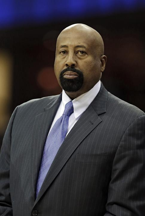 New York Knicks head coach Mike Woodson watches from the bench before an NBA basketball game against the Cleveland Cavaliers, Tuesday, Dec. 10, 2013, in Cleveland