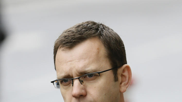 "Andy Coulson, the ex-communications chief for Prime Minister David Cameron, arrives for a bribery hearing at the Old Bailey court in the City of London, Friday, March 8, 2013, in London.  Coulson is appearing to answer charges relating to the alleged requesting and authorising of payments to public officials in exchange for information, including a royal phone directory known as the ""green book"". Coulson denies the charges. (AP Photo/Kirsty Wigglesworth)"