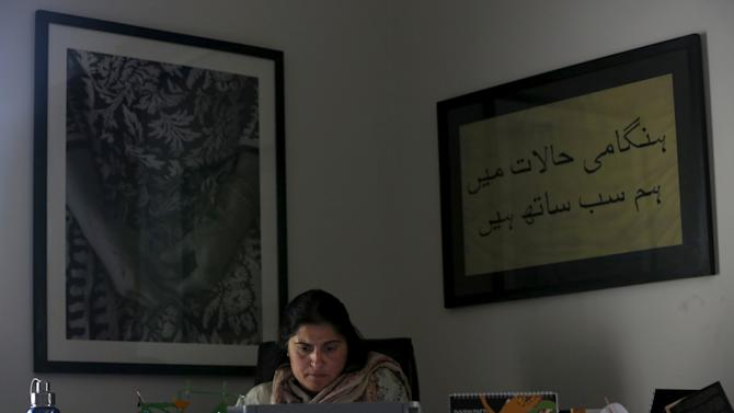 Pakistani journalist and filmmaker Sharmeen Obaid-Chinoy works on her computer at her office in Karachi
