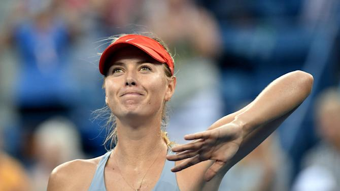 Maria Sharapova of Russia waves to the crowd after defeating Alexandra Dulgheru of Romania during their US Open women's singles match, in New York, on August 27, 2014