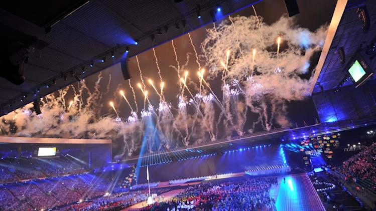 Fireworks light up the sky during the opening ceremony of the 2014 Commonwealth Games at Celtic Park in Glasgow on July 23, 2014