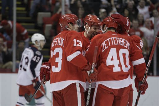 Red Wings top Blue Jackets 7-2, clinch playoff bid