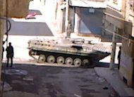 An image taken from YouTube shows what appears to be a Syrian army tank in the northeastern city of Deir al-Zor