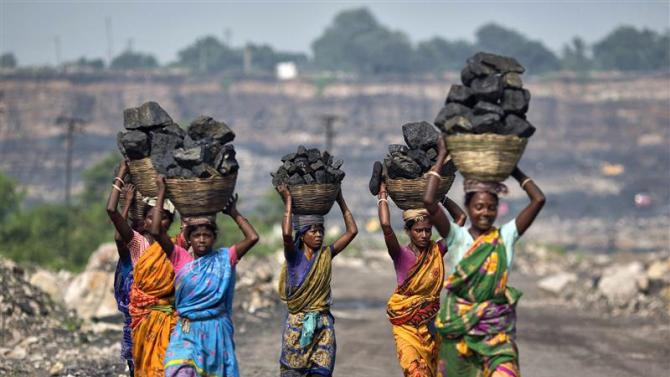File picture of local women carrying coal taken from open cast coal field at Dhanbad district in Jharkhand