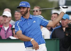 Dustin Johnson of the U.S. watches his tee shot during the final round of the British Open Championship at the Royal Liverpool Golf Club in Hoylake