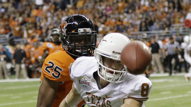 Texas' Jaxon Shipley (8) misses a pass as Oregon State's Ryan Murphy (25) defends during the first quarter of the Alamo Bowl NCAA football game, Saturday, Dec. 29, 2012, in San Antonio.  (AP Photo/Eric Gay)
