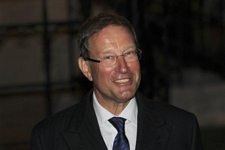 Express newspapers owner Richard Desmond smiles as he leaves after giving evidence to the Leveson Inquiry at the High Court in London