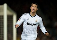 BARCELONA, SPAIN - FEBRUARY 26: Cristiano Ronaldo of Real Madrid celebrates scoring his sides opening goal during the Copa del Rey semi final second leg match between FC Barcelona and Real Madrid CF at the Camp Nou on February 26, 2013 in Barcelona, Spain.  (Photo by Jasper Juinen/Getty Images)