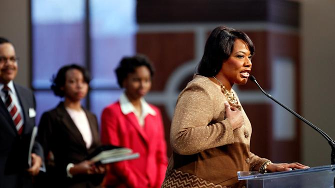 Dr. Bernice King, daughter of Dr. Martin Luther King Jr., right, speaks during the annual Dr. Martin Luther King Jr. holiday commemorative service at the Ebenezer Baptist Church, Monday, Jan. 21, 2013, in Atlanta. The nation will honor civil rights leader Martin Luther King Jr. on Monday, the same day as it celebrates the inauguration of the first black president to his second term. (AP Photo/David Goldman)