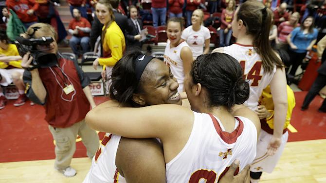 Iowa State guard Fallon Ellis, left, celebrates with teammate Brynn Williamson after an NCAA college basketball game against Baylor, Saturday, Feb. 28, 2015, in Ames, Iowa. Ellis scored a career-high 18 points as Iowa State won 76-71. (AP Photo/Charlie Neibergall)