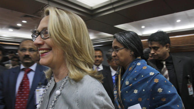 U.S. Secretary of State Hillary Rodham Clinton, left, and Bangladesh Foreign Minster Dipu Moni leave after a joint press conference in Dhaka, Bangladesh, Saturday, May 5, 2012. Clinton is in Bangladesh to press tolerance, democracy and development in one of the world's most impoverished nations that is now in the throes of political turmoil. (AP Photo/Pavel Rahman)