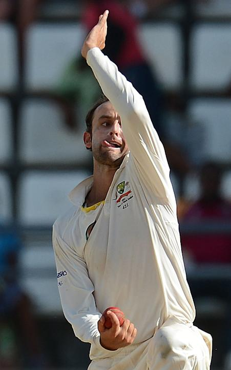 Australian bowler Nathan Lyon makes a delivery during the second day of the third test match between the West Indies and Australia in Roseau, on April 24, 2012. Australia is leading the three-test ser