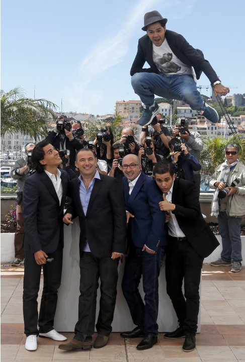 "Director Mohamed Hamidi and cast members pose during a photocall for the film ""Ne quelque part"" at the 66th Cannes Film Festival"